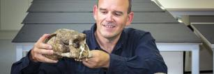 Stephen Munro examines casts of Homo erectus.