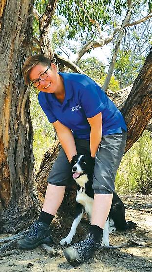Emma and her dog Mojo. While Mojo is not looking for threatened species herself, she will be mother to a new generation of conservation dogs with some of her puppies expected to work in Melbourne Zoo's threatened species program. Credit: Leah Denadic