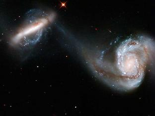 Figure 1. Two galaxies in the process of merging. Credit: NASA, ESA, and the Hubble Heritage Team (STScI/AURA)