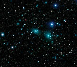 An image of the centre of the Coma Cluster. Green dots show the distribution of thousands of faint dwarf galaxies, which do not include the recent discoveries of large, ultra-diffuse galaxies. In this crowded region of space, galaxies will frequently interact gravitationally with one another and the underlying dark matter of the cluster itself. Credit: NASA/JPL-Caltech/GSFC/SDSS