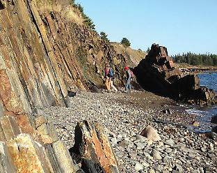 Members of the team sampling 480-million-year-old black shales from the Meguma Terrain in Nova Scotia, Canada.