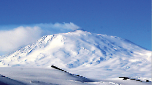 Mount Erebus is perhaps the most well-known volcano in Antarctica, and is one of the large volcanoes that may have sheltered life through past ice ages. Photo: Steven Chown