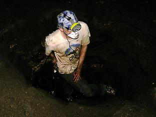 Christopher Wurster digging a guano pile in Gomantong Caves, Sabah, Malaysia.