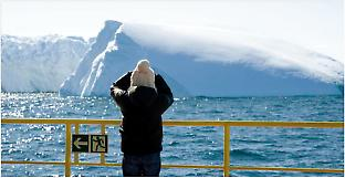 An Expedition 318 scientist observes an iceberg.